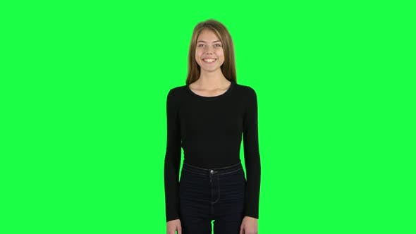 Thumbnail for Young Woman Smiling While Looking at Camera and Rejoicing. Green Screen