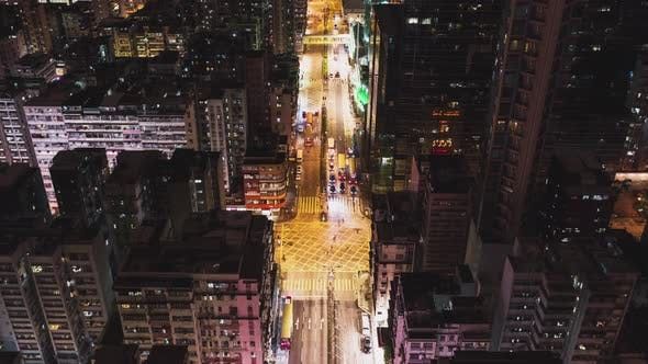 Thumbnail for Hyperlapse time-lapse of car traffic at night in Hong Kong downtown district, drone aerial top view