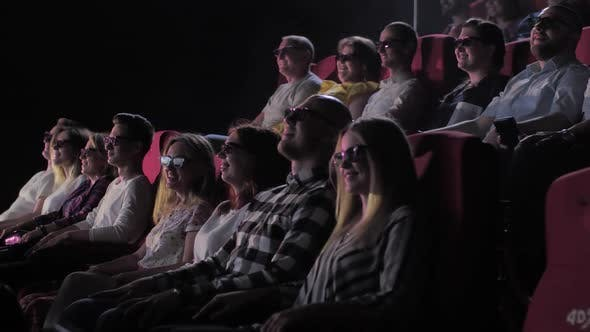 Spectators Watching 3d Movie in 4Dx Cinema Hall