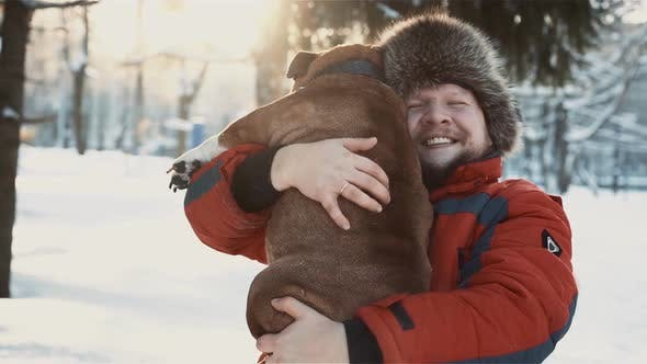 Thumbnail for Happy Bearded Man Hugging His Bulldog at Winter Sunny Day, Friendship, Xmas, Winter, Pet Concept