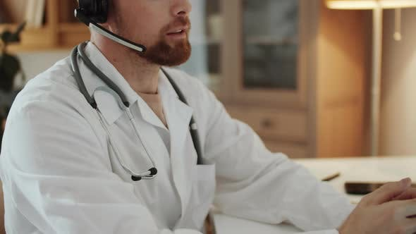 Thumbnail for Male Practitioner Consulting Patient on Video Call