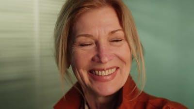 Beautiful Mature Woman Smiling at Camera
