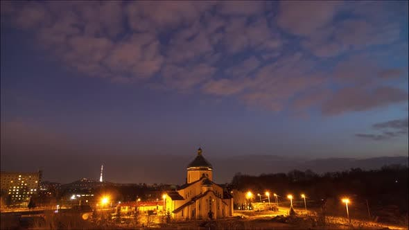 Beautiful time lapse day to night: clouds and stars moving by city sky.