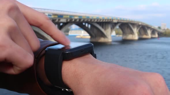 Thumbnail for Woman Using A Smart Watch In The City