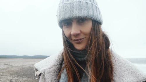 Close-up Portrait of Beautiful Happy Female Tourist Smiling at Camera, Posing at Cold Windy Winter