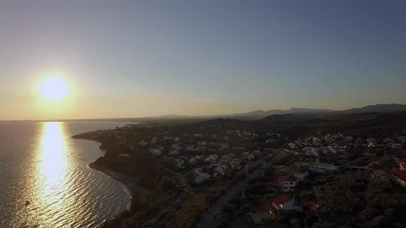 Thumbnail for Aerial Sunset Scene of Sea and Coastline with Houses in Trikorfo Beach, Greece