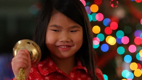 Thumbnail for Young girl shaking Christmas bell