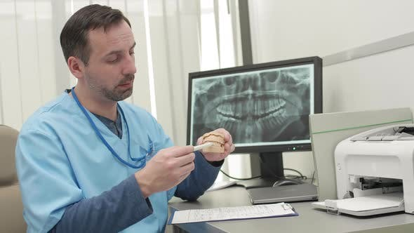 Thumbnail for Male Dentist Telling about Impression of Jaw
