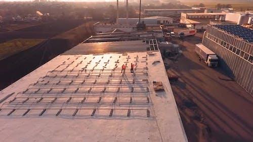 Solar technician installing panels. Installing alternative energy photovoltaic solar panels on roof