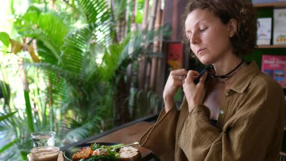 Caucasian Woman Takes Off Her Face Mask to Eat Her Vegan Salad for Lunch