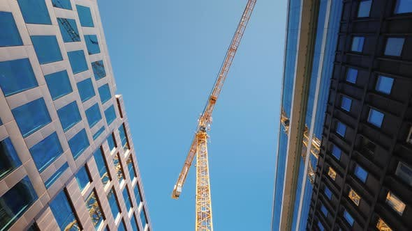 A Large Tower Crane in the Downtown of the Modern City