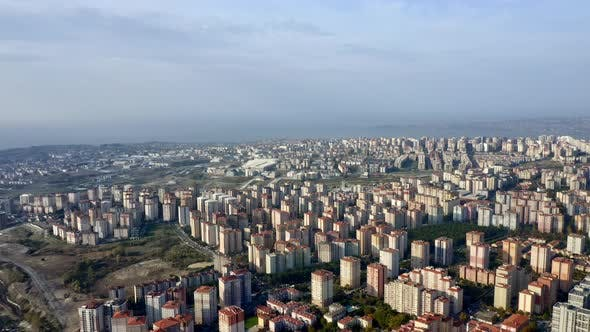 Aerial View of Tall Buildings in Istanbul, Lush Grass Fields and Lake