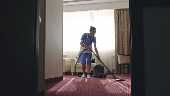 Thumbnail for Housemaid Vacuuming Hotel Room