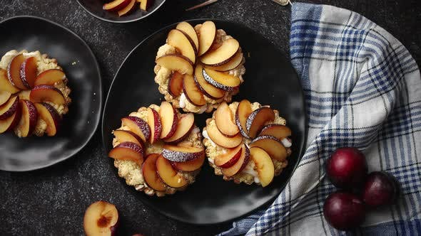 Homemade Mini Tarts with Fresh Sliced Plum Fruit