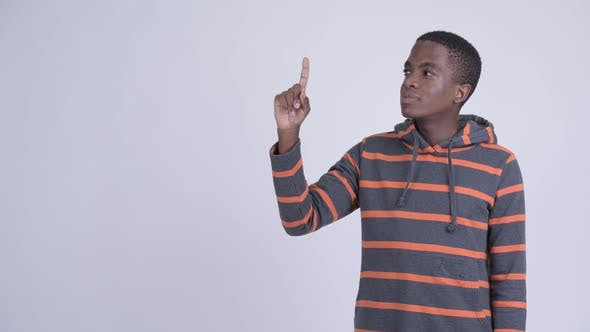 Thumbnail for Young Happy African Man Thinking and Pointing Up