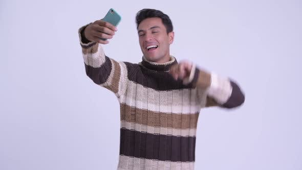 Thumbnail for Young Happy Hispanic Man Taking Selfie Ready for Winter
