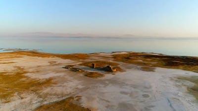 Historical ruins and sea view at sunset.