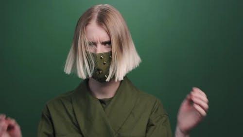 Female Model in Studded Face Mask Posing