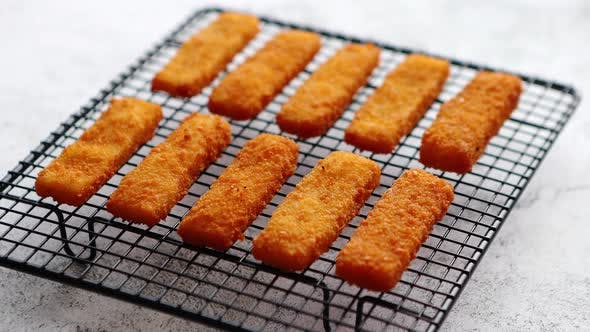 Thumbnail for Rows of Golden Fried Fresh Fish Fingers Fillets