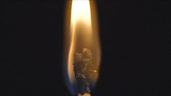 Close up shot of a wooden match flames and blow out