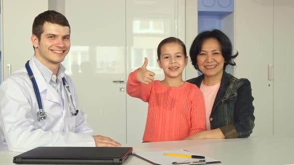 Thumbnail for Little Girl Shows Her Thumb Up Near the Doctor