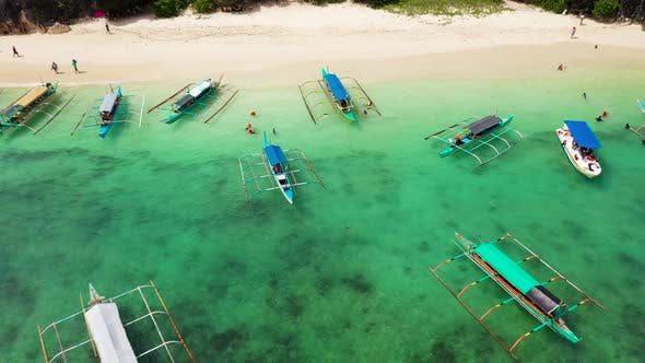 Caramoan Islands, Camarines Sur, Matukad. Philippines. Boats and Tourists on the Beach.