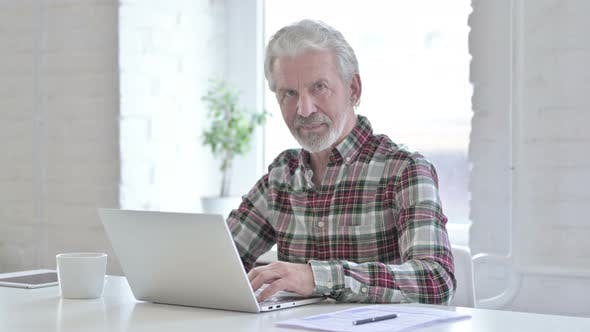 Ambitious Casual Old Man Doing Thumbs Up in Office