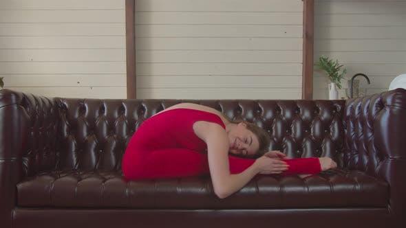 Thumbnail for Flexible Woman Doing Yoga Asana Seated Forward Bend