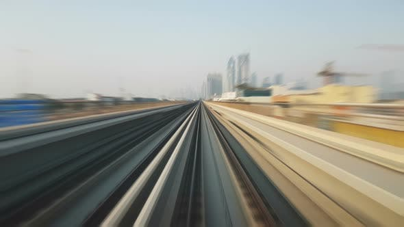 Thumbnail for Dubai Metro From a Front Locomotive Moving Extremely Fast on a Sunny Day , Time Lapse