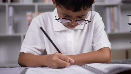 A boy doing homework.