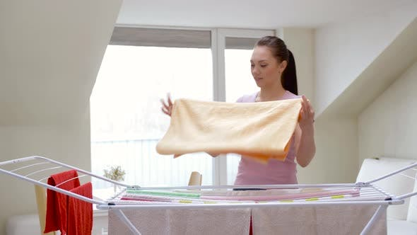 Thumbnail for Woman Taking Bath Towels From Drying Rack at Home