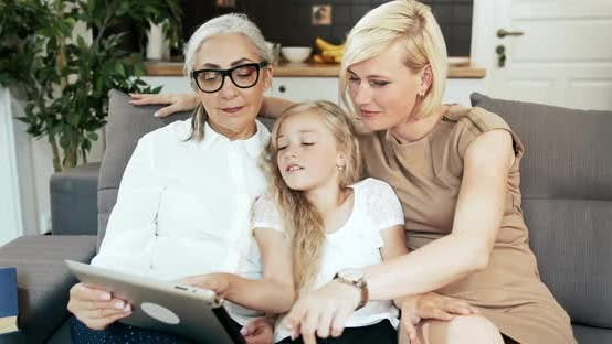 Thumbnail for Family with Tablet on Sofa
