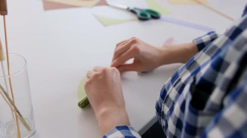 Woman Making Paper Craft at Home