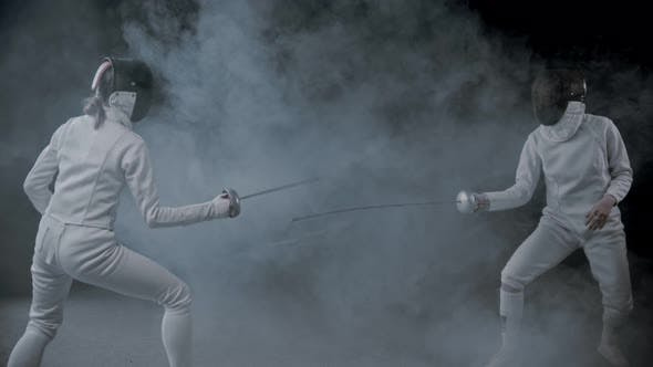 Thumbnail for Fencing Training - Two Women Having a Duel in the Smoky Studio