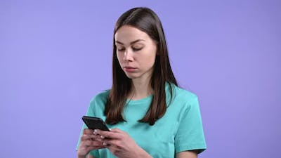 Woman Using Mobile Phone on Violet Background