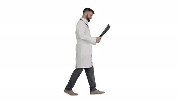 Thumbnail for Medical Doctor Walking and Looking at Xray Picture of Lungs on White Background