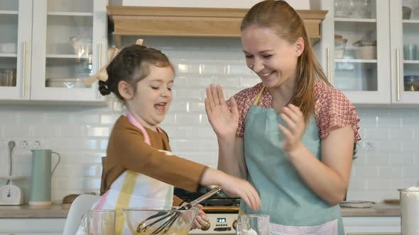 Thumbnail for Little Girl and Mother Play with Flour Cooking Tasty Cake