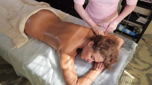 Young Woman in a Massage Session.