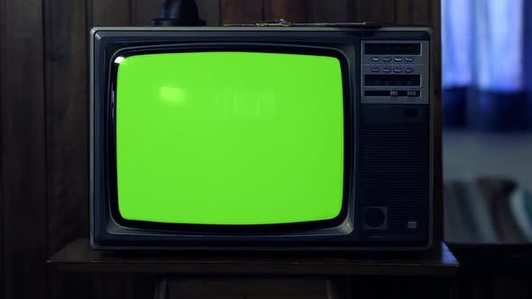 Thumbnail for Retro TV turning on Color Bars and Green Screen at Night.