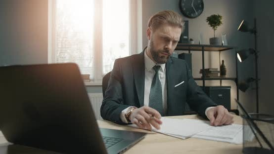 Thumbnail for Businessman Working on Laptop in Office