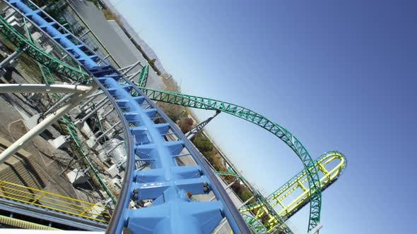 Thumbnail for First person view of a roller coaster riding the peaks and slopes of the track