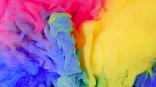 Ink Color Mix Paint Falling on Water Colorful Ink in Water  Footage Red Blue Orange Yellow
