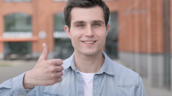 Thumbnail for Thumbs Up by Young Man Standing Outdoor