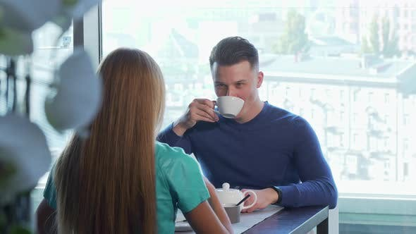 Thumbnail for Handsome Cheerful Man Having Date with His Girlfriend Enjoying Breakfast Together