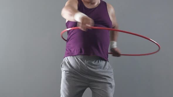 Thumbnail for Funny Fatty Man Learning how To Twist Hula-Hoop, Wants to Have Thin Waist