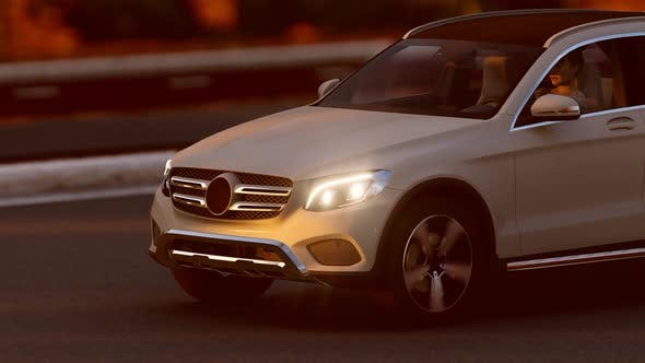 Thumbnail for Close Up White Luxury SUV Progressing Forest Road
