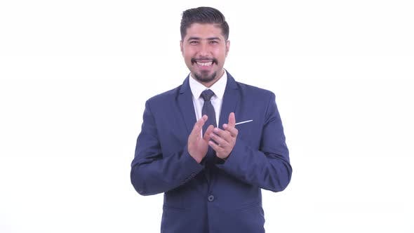 Thumbnail for Happy Bearded Persian Businessman Clapping Hands