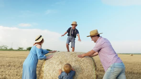 Thumbnail for Parenting, Family Having Fun on Field of Riding Children on Haystack