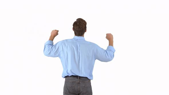 Thumbnail for Rearview of businessman raising his arms in excitement