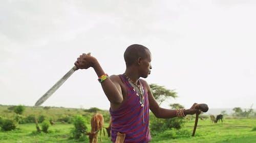Maasai warrior preparing to throw a machete